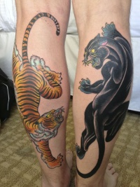 Black panther and tiger tattoo on feet
