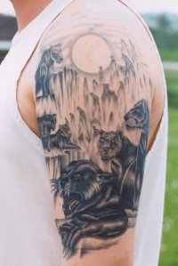 Black panthers and moon tattoo on half sleeve