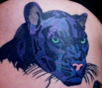 Blue ink panther head tattoo
