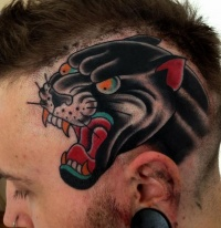 Coloured head of evil black panther tattoo on head